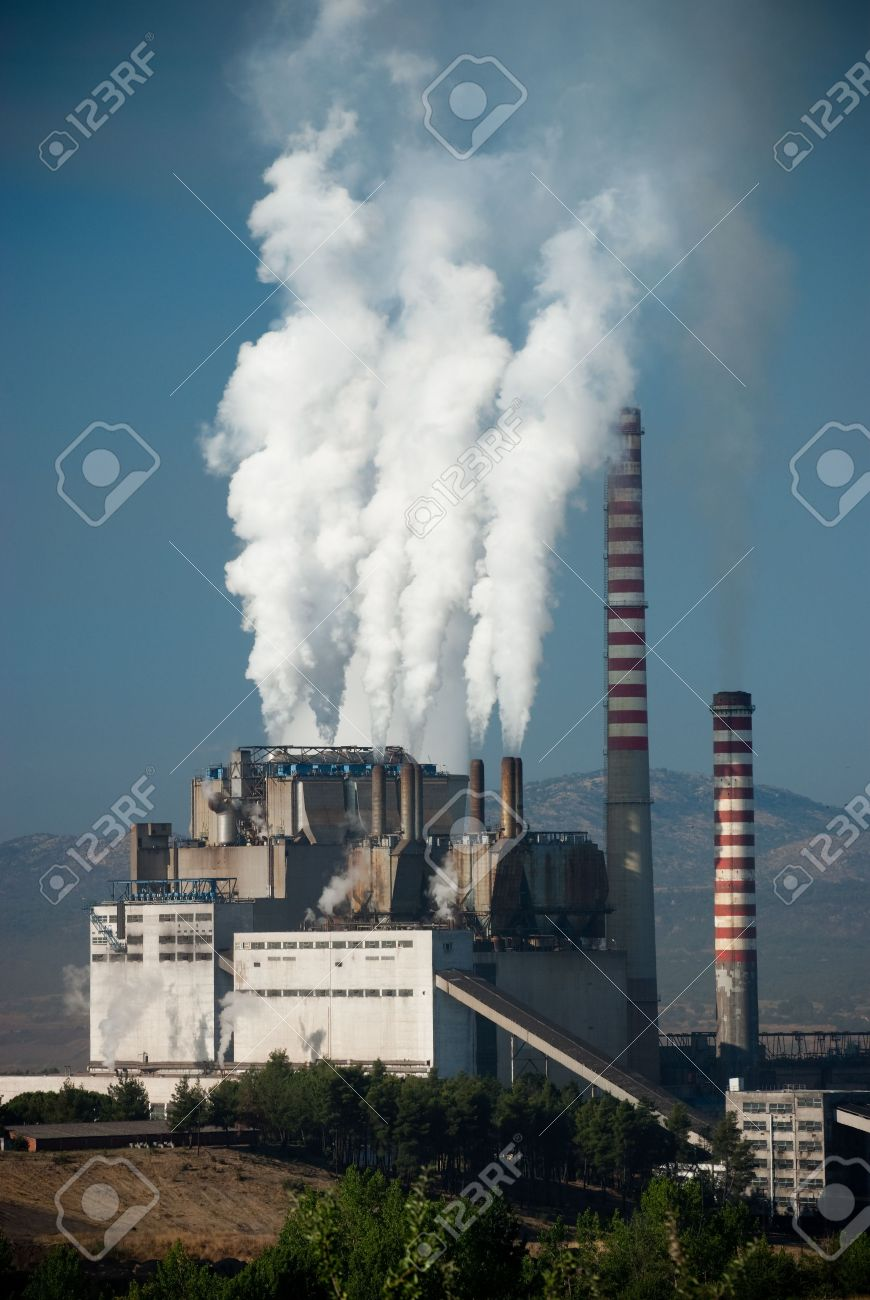 Steaming smoke stack and cooling tower with pollution in Megalopolis, Greece Stock Photo - 5406371