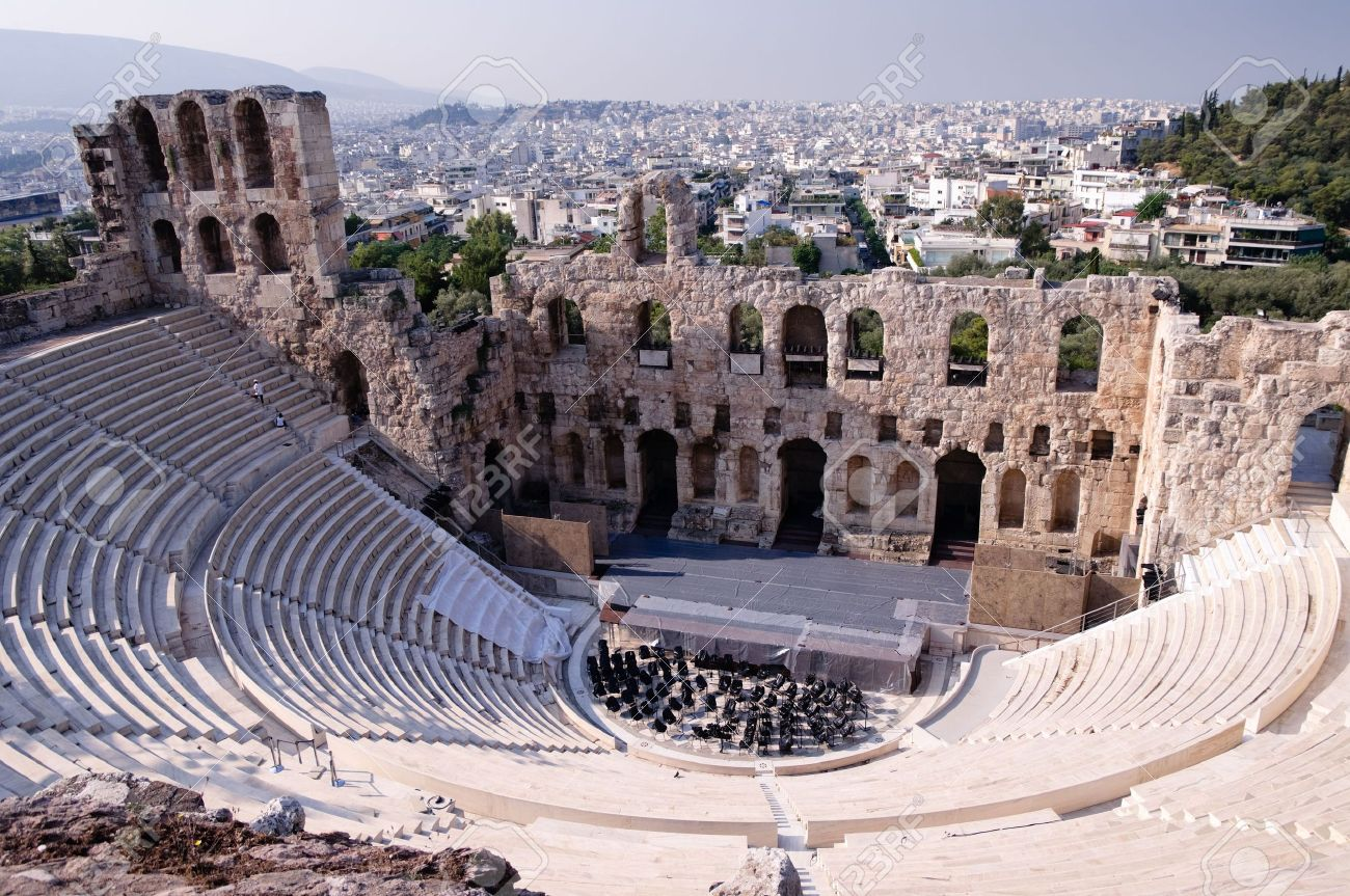 Ancient theatre of Herodes Atticus  is a small building of ancient Greece used for public performances of music and poetry, below on the Acropolis and in background dwelling of metropolis Athens Stock Photo - 5701293