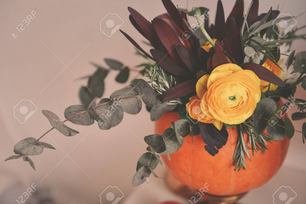 Autumn Floral Bouquet In A Pumpkin Vase For Halloween Table Stock Photo Picture And Royalty Free Image Image 106147103