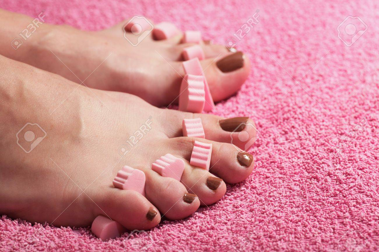 foot pedicure applying pink background Stock Photo - 8203851