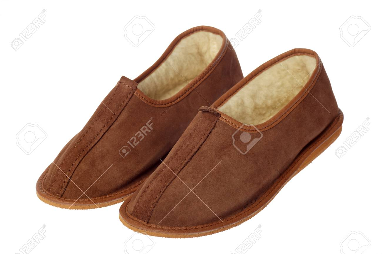 34d13fadc8e isolated brown wool comfortable slippers Stock Photo - 8823514