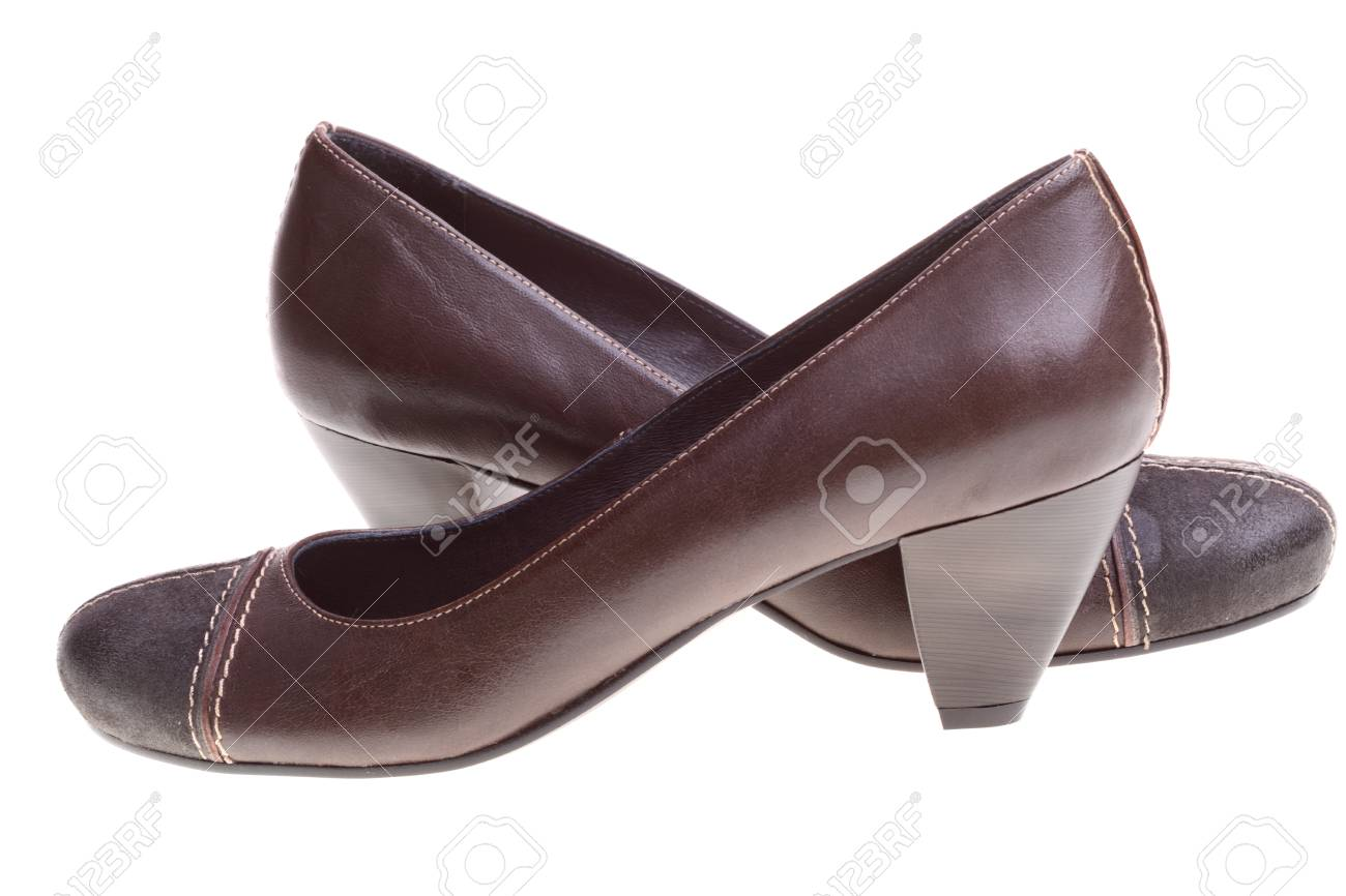 Woman brown shoes on the white background Stock Photo - 9732351