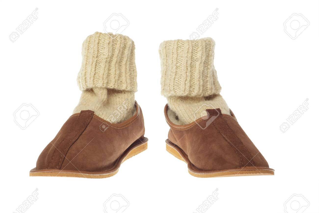 49f2e65c746 isolated brown wool comfortable slippers Stock Photo - 10074828