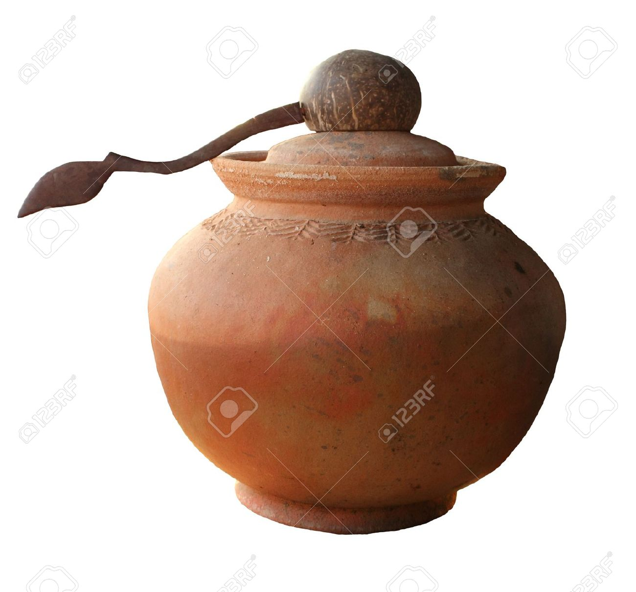 A clay pot to fill water and a deep spoon made of coconut shell Stock Photo - 9138574