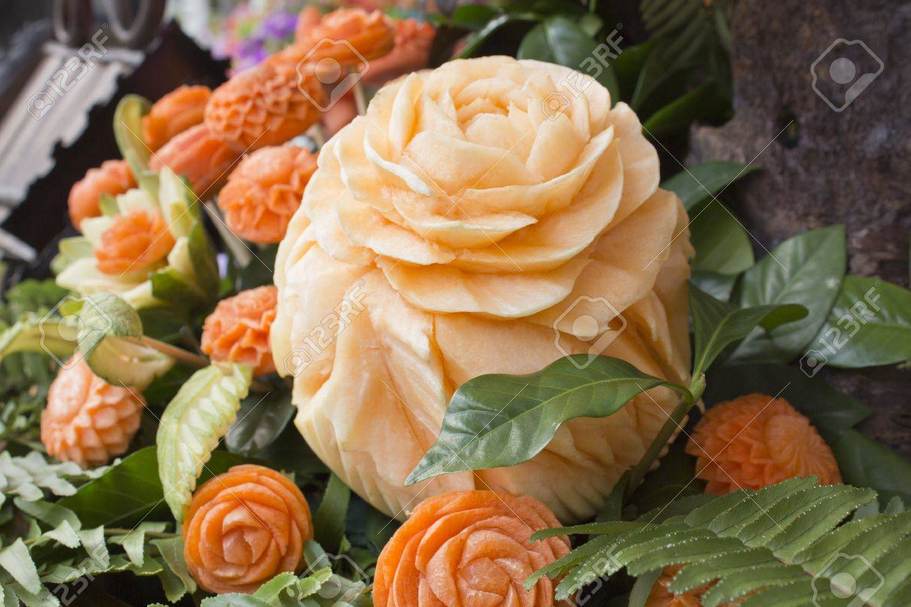 Thai art of carved cantaloup and carrots like a flower Stock Photo - 13652349