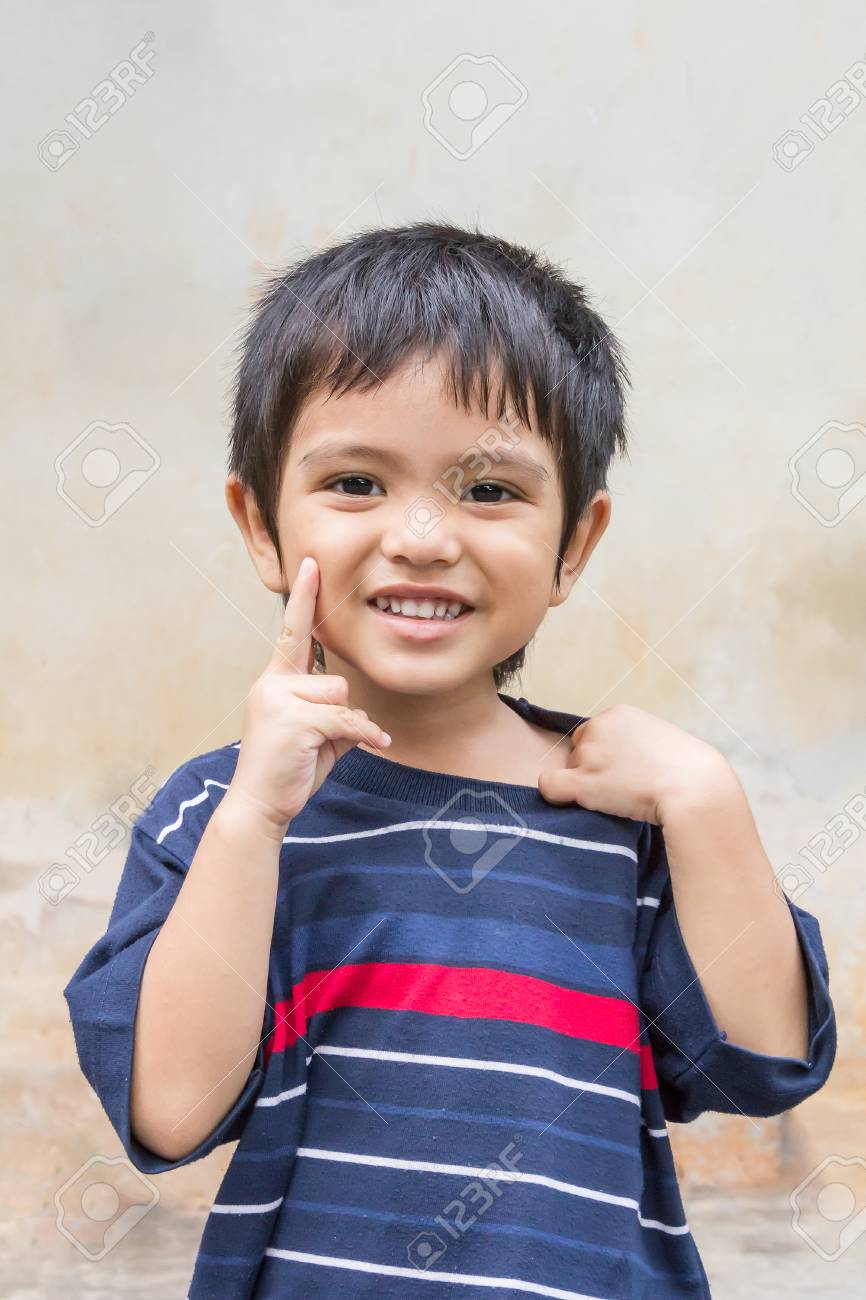 Cute Outdoor Portrait Of Happy Smiling Asian Thai Little Boy Stock Photo 57864299