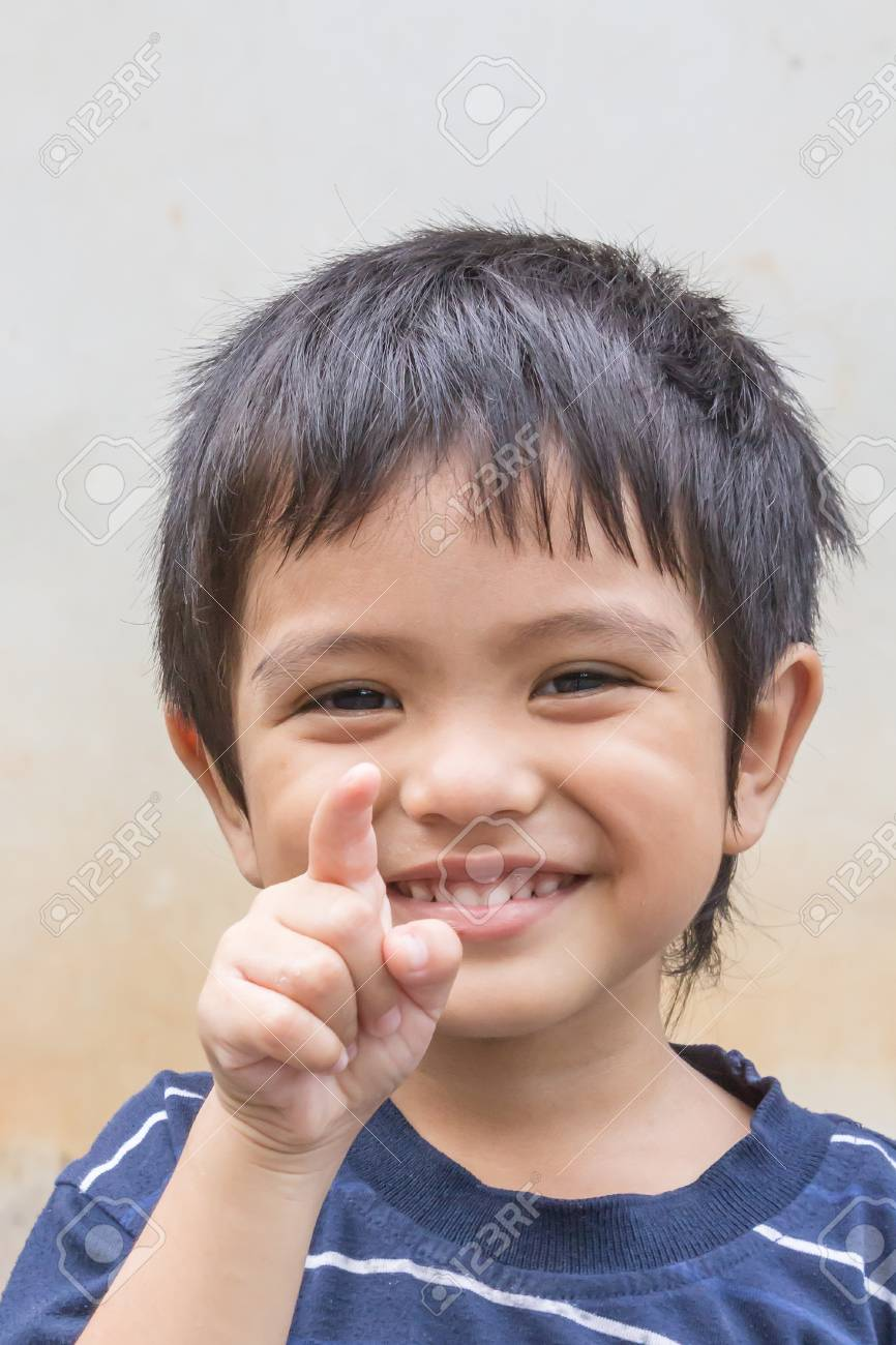 Cute Outdoor Portrait Of Happy Smiling Asian Thai Little Boy Stock Photo 57864301