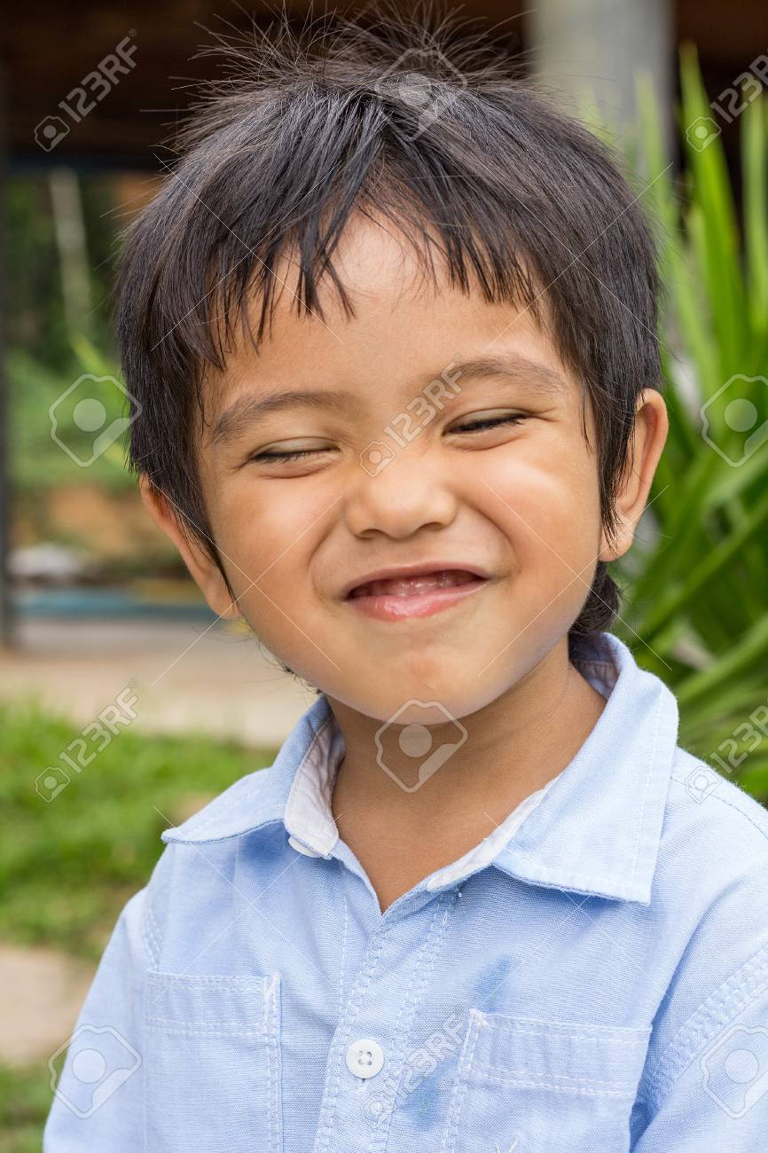 Cute Outdoor Portrait Of Happy Smiling Asian Thai Little Boy Stock Photo 57864302