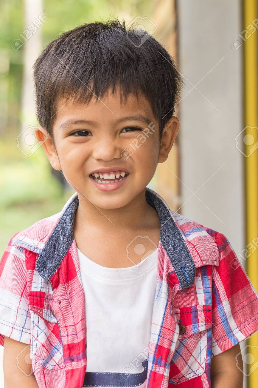 Cute Outdoor Portrait Of Happy Smiling Asian Thai Little Boy Stock Photo 57874681