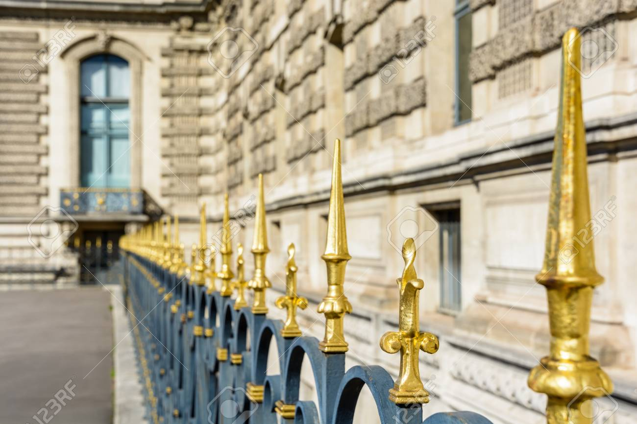 View Of A Heavy Black Wrought Iron Fence Topped With Golden Spikes ...