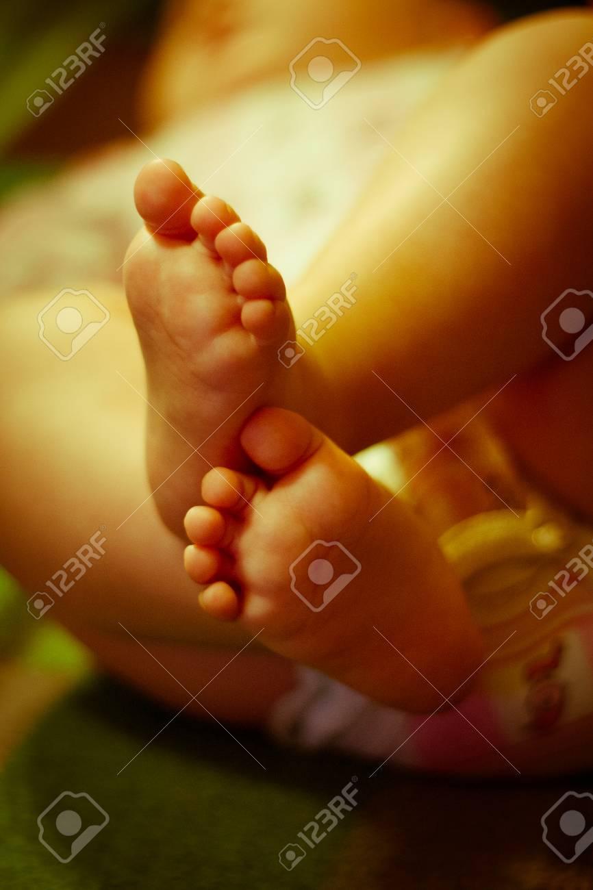 Small beautiful legs of a newborn baby stock photo 39015257
