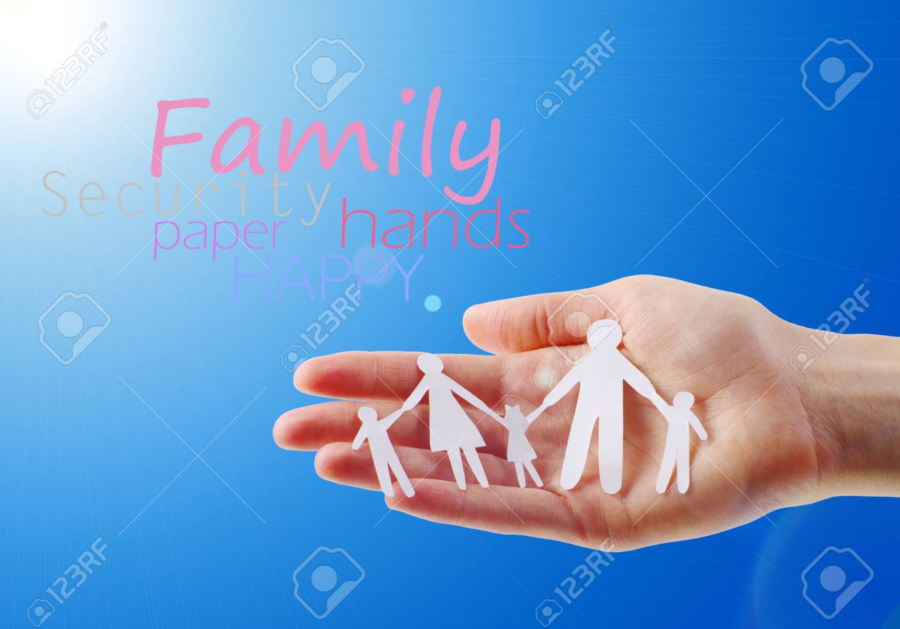 Paper family in hands isolated on blue sky - 12663324