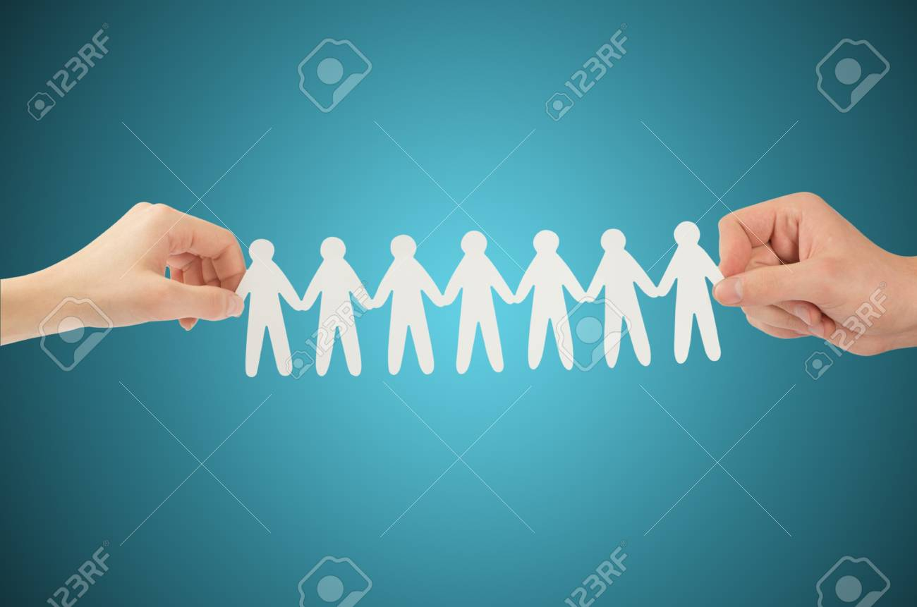 paper people in hands(man and woman) Stock Photo - 12662986