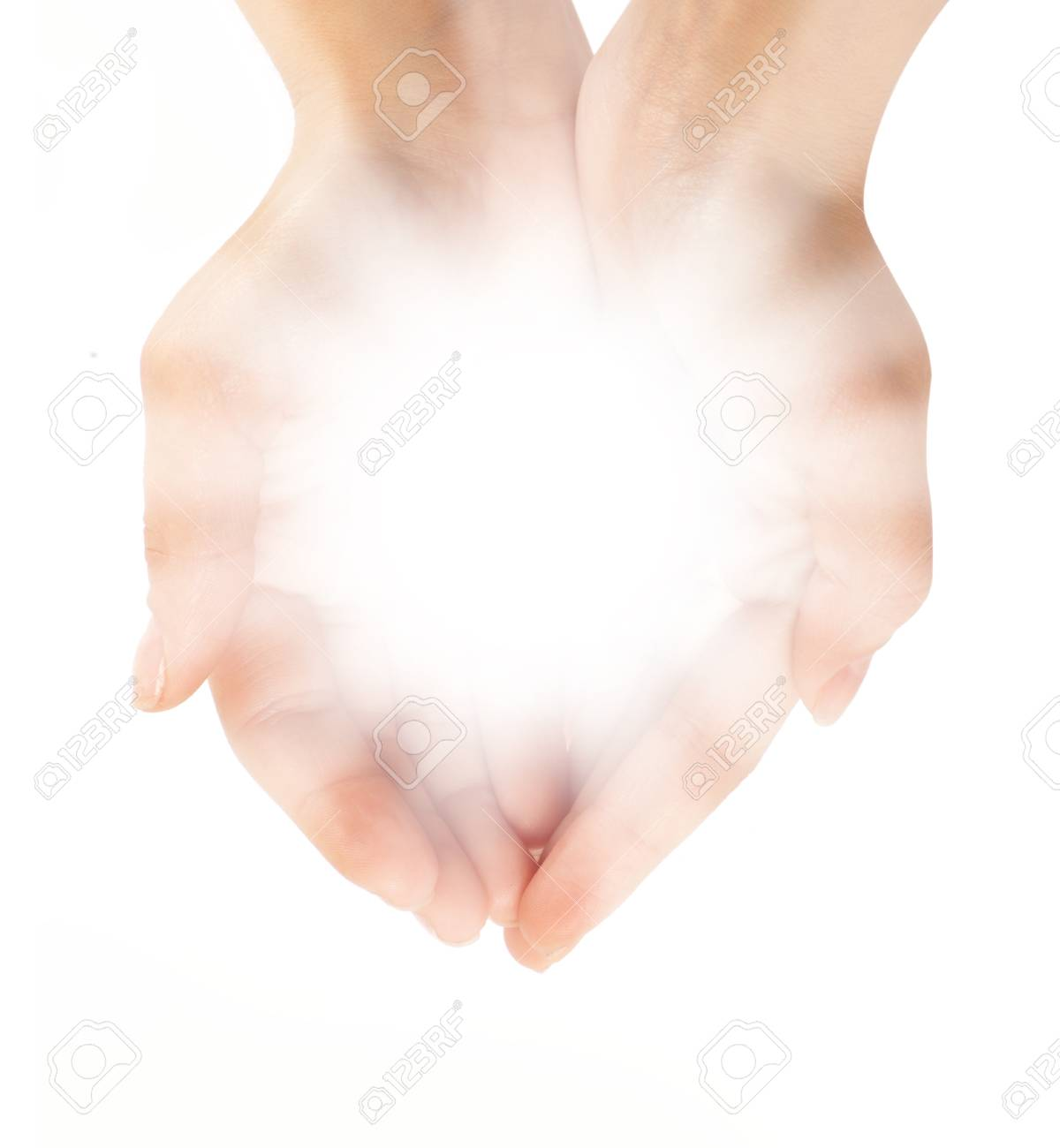 Female hands holding a brilliant shine in the dark Stock Photo - 12706417