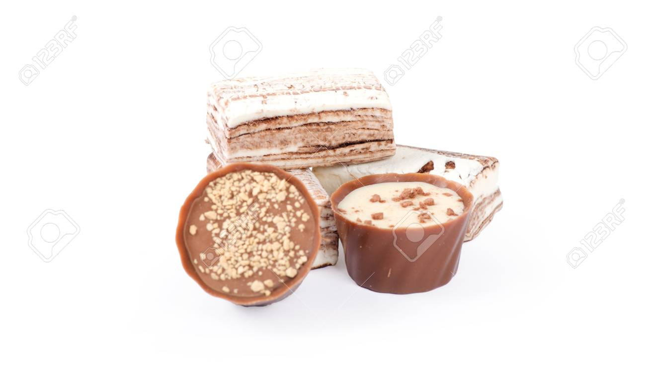 Chocolate and nuts over white Stock Photo - 13651476