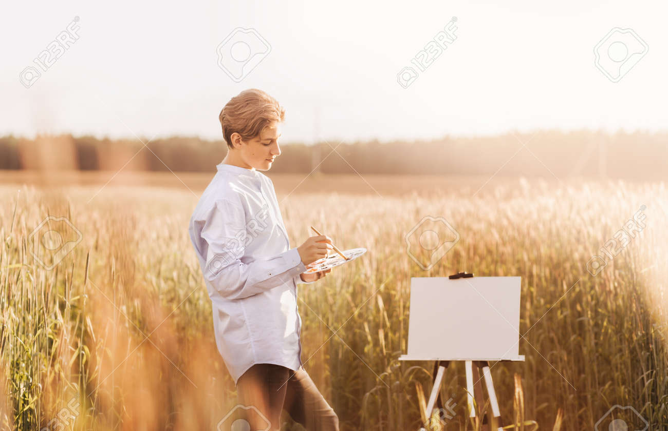 Portrait of a beautiful of millennial boy in nature in the summer. Vertical - 171109527