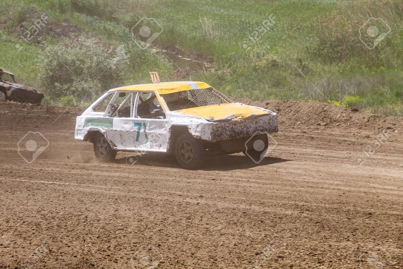 Old Wrecked Cars Stock Race. Racing In The Open Air With Dust Stock ...