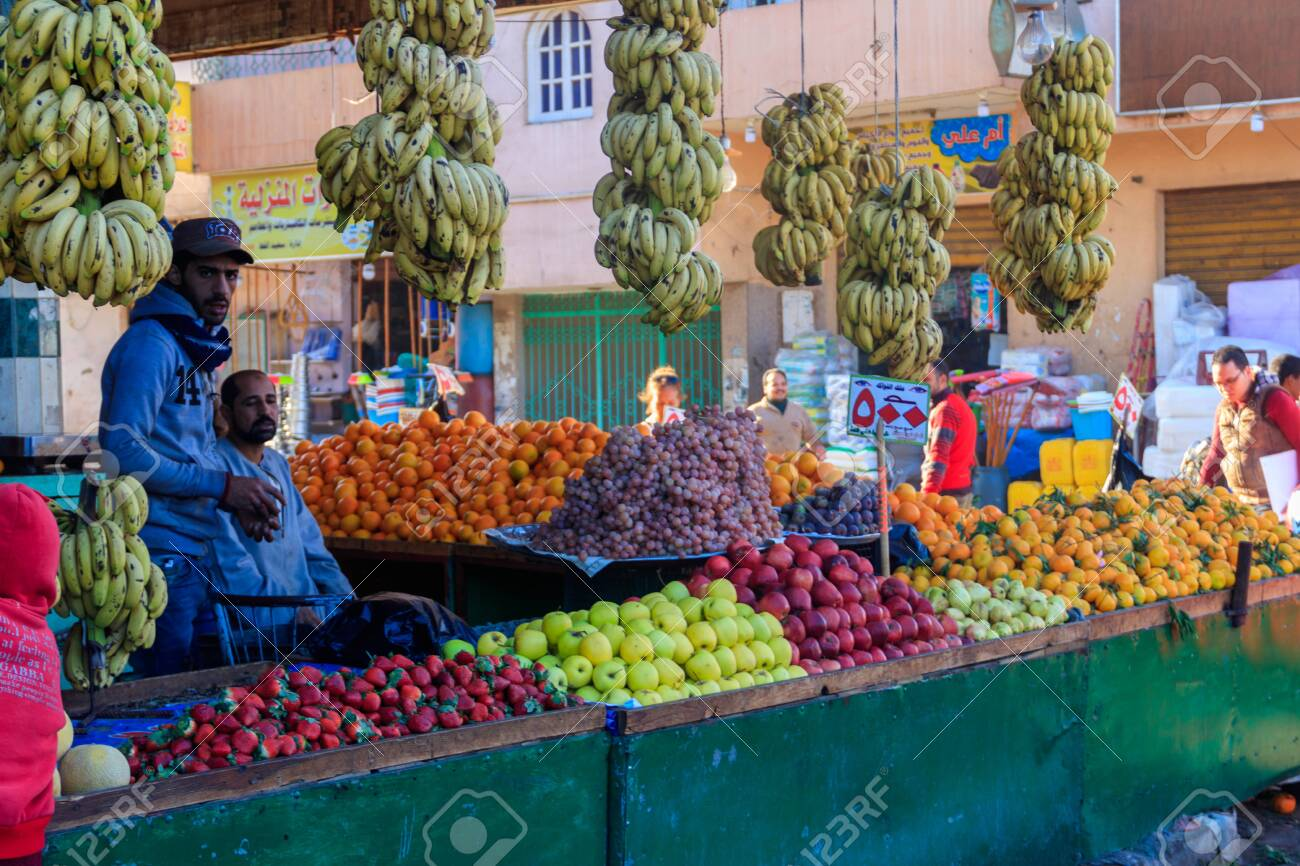 Hurghada, Egypt - December 9, 2018: Sellers and customers at local fruit market in Hurghada - 141899285