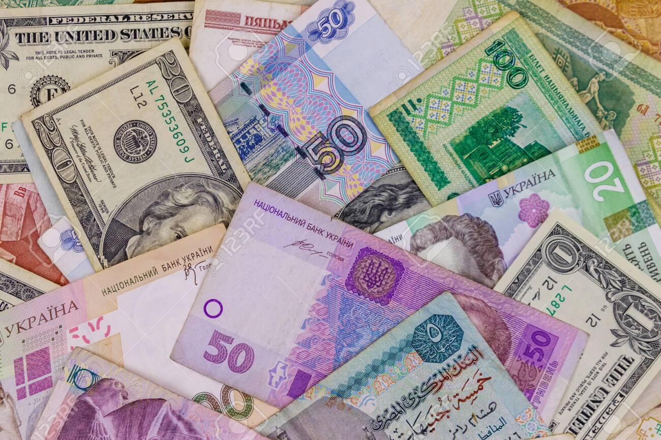 Multicurrency background of US dollars, Russian rubles, Belarusian rubles, Egyptian pounds and Ukrainian hryvnias - 130488097