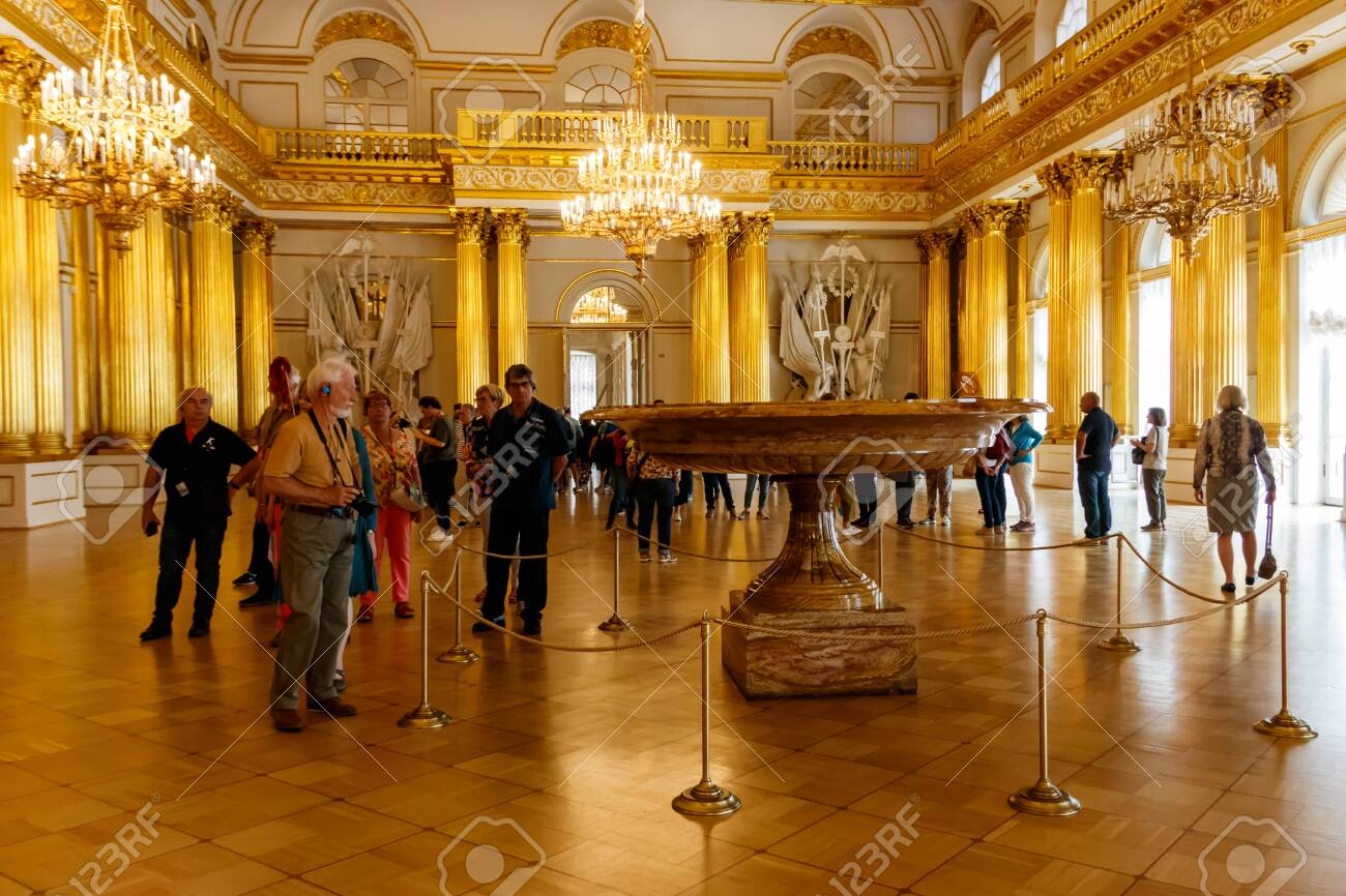 St. Petersburg, Russia - June 26, 2019: Visitors in Armorial Hall of Winter palace (State Hermitage Museum) in St. Petersburg, Russia - 141720002