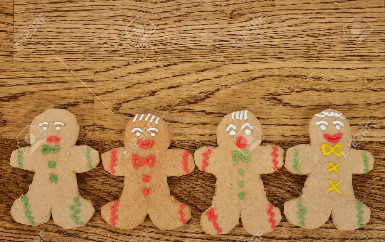 Gingerbread men on a brown background Stock Photo - 21718182