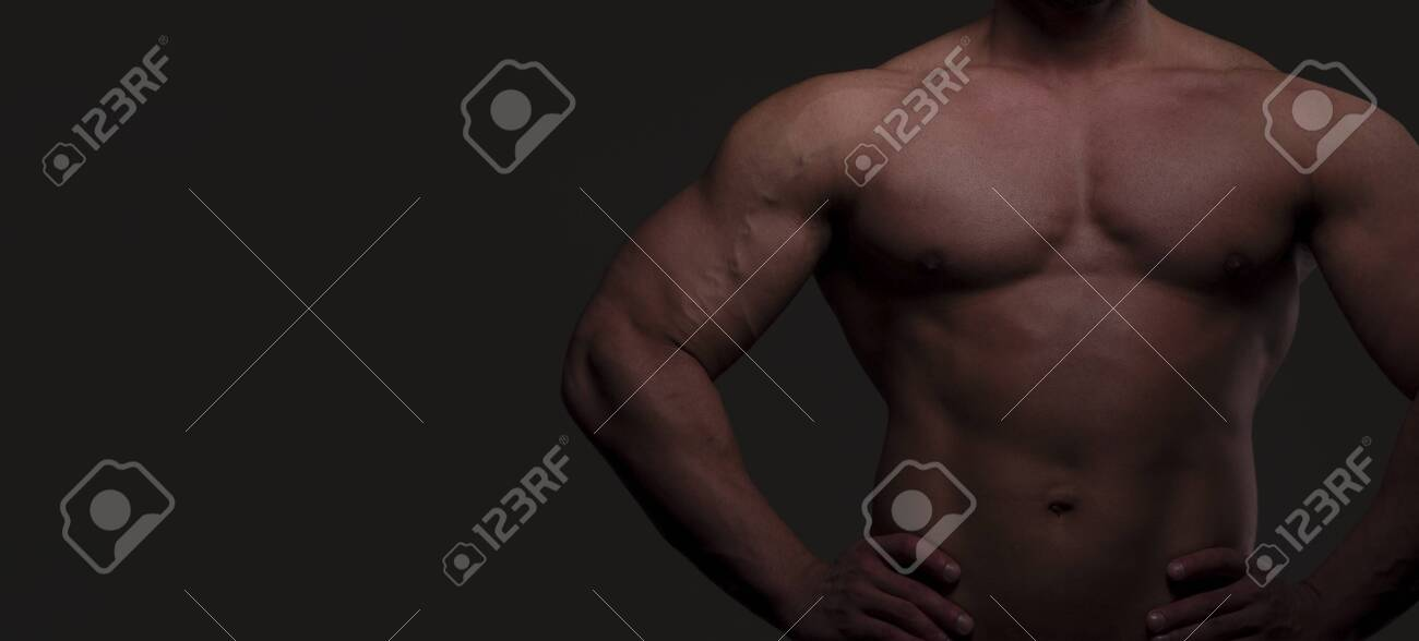 Closeup Torso Of Athletic Guy With Perfect Abs Sport Banner With Stock Photo Picture And Royalty Free Image Image 140947290