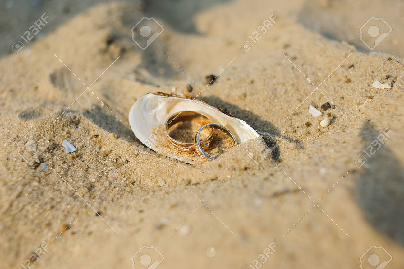 copyspace concept vacation stock starfishes vertical on color gold wedding image rings photo white beach with free