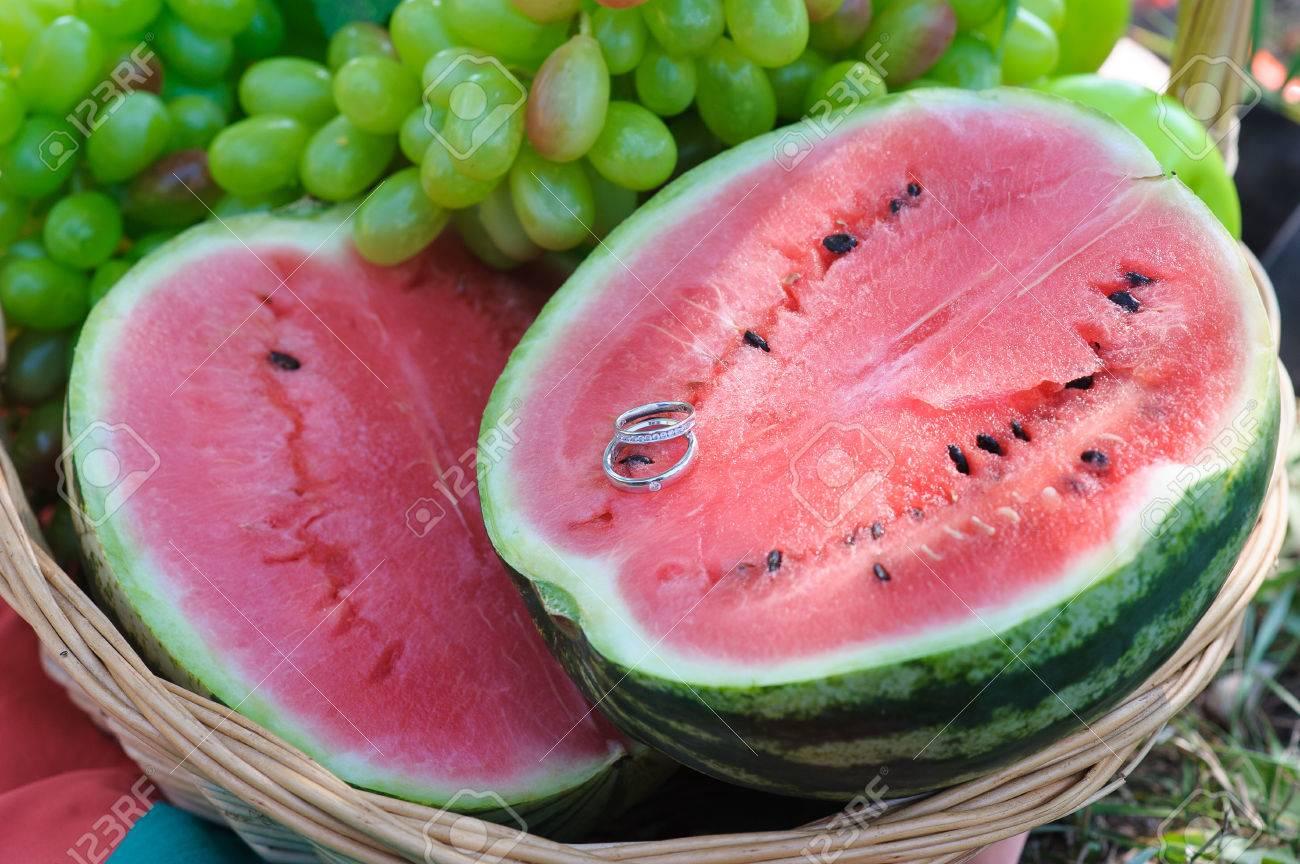 Two Wedding Rings On Half A Watermelon. Beautiful Juicy Watermelon ...