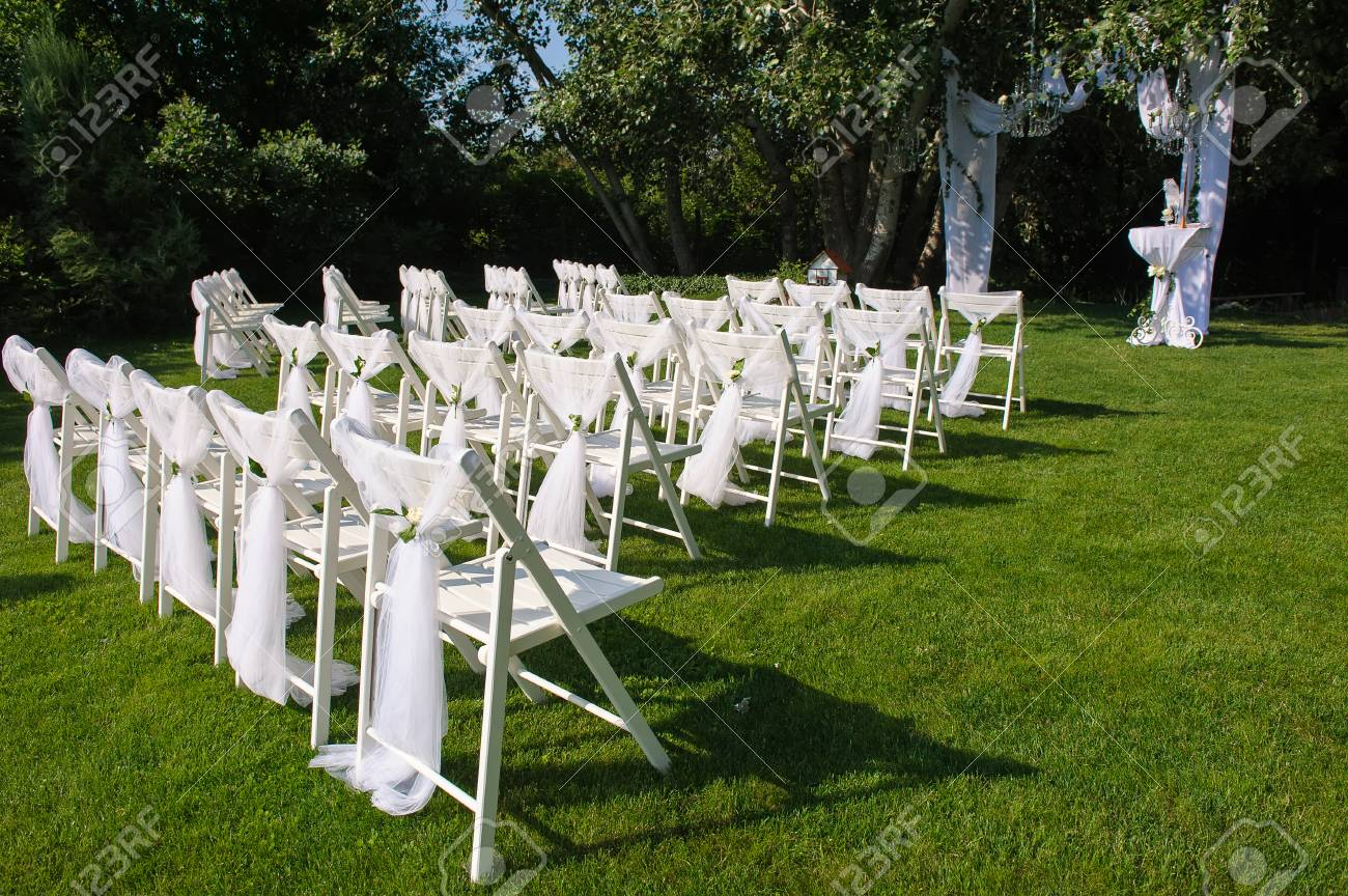 Arch For Wedding Ceremony White Decorated Chairs On A Green Stock Photo Picture And Royalty Free Image Image 60976059
