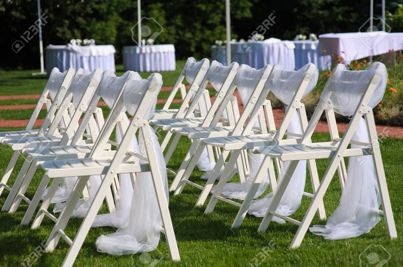White Decorated Chairs On A Green Lawn Chairs Set In Rows For Stock Photo Picture And Royalty Free Image Image 60976029