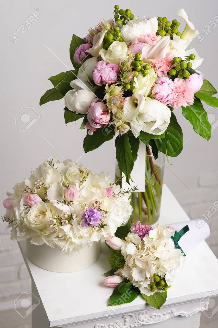 Bouquet Of White Peonies Flower Composition On White Table Stock