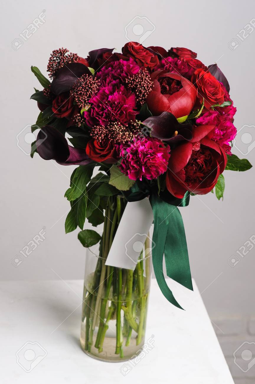 flower arrangement. Bouquet of red peonies. flowers in a glass vase. Stock Photo & Flower Arrangement. Bouquet Of Red Peonies. Flowers In A Glass ...