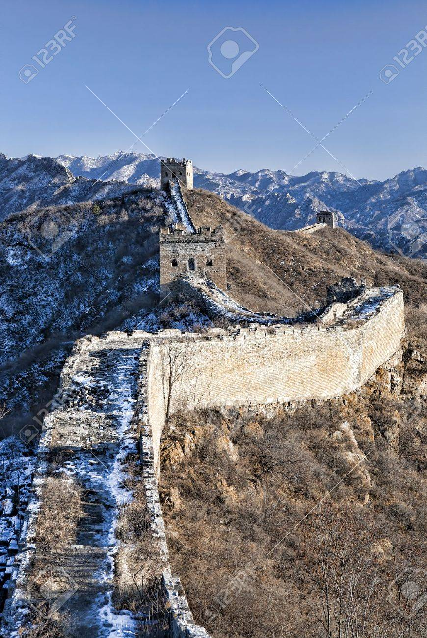 Great Wall in snow in winter on bright sunny day between Jinshanling and Simatai, China Stock Photo - 17317448
