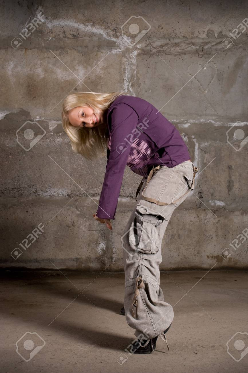 Beautiful hip hop girl dancing over grey brick wall Stock Photo - 8398318