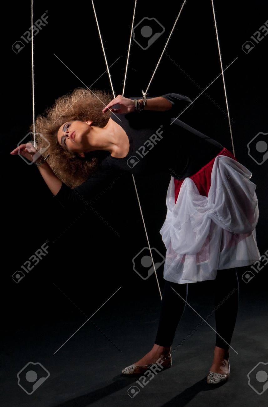 Beautiful doll women with control line standing on black Stock Photo - 8574442