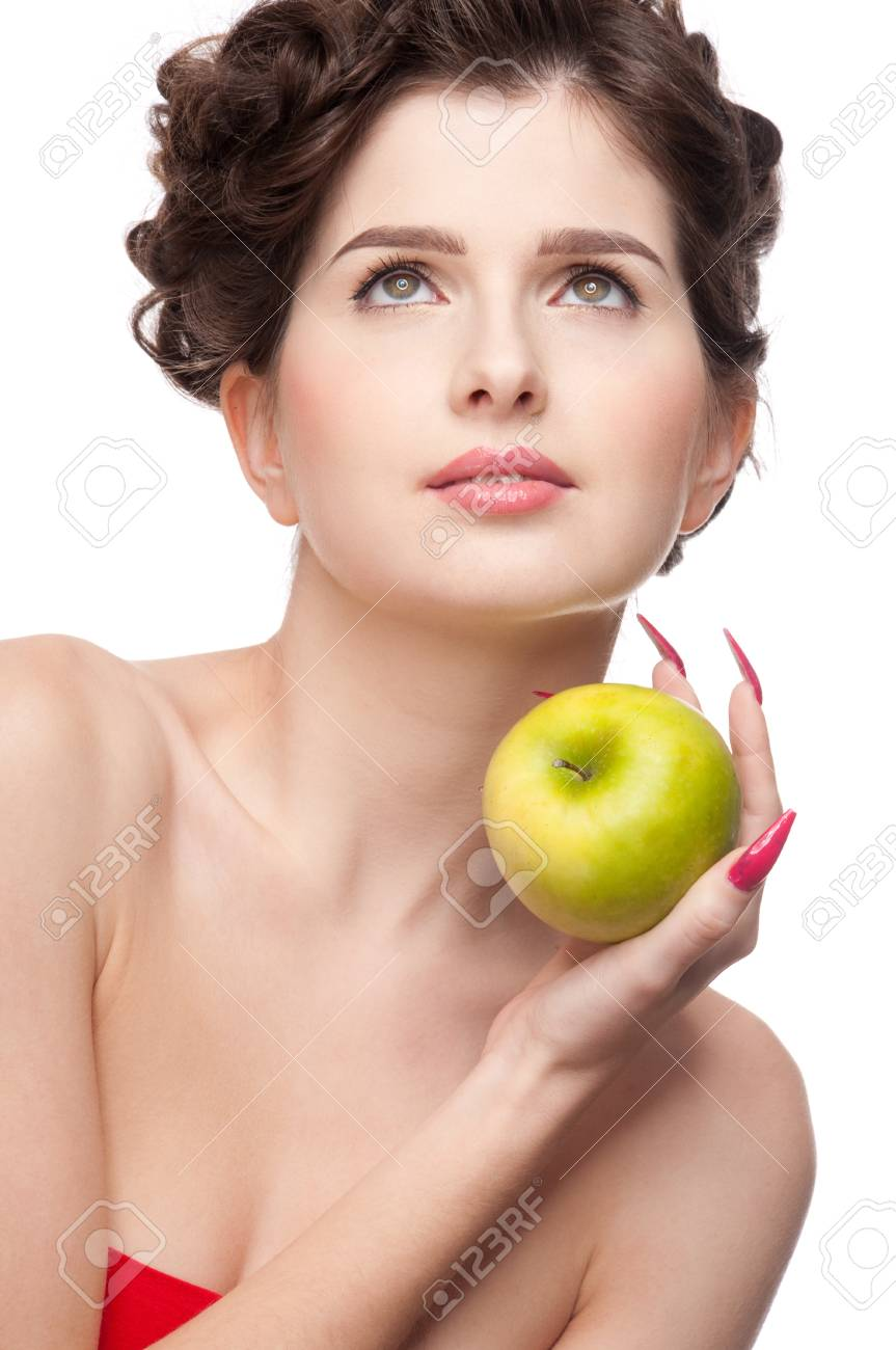 Close up portrait of young beauty woman with green apple. Perfect skin! Isolated on white. Stock Photo - 8571825