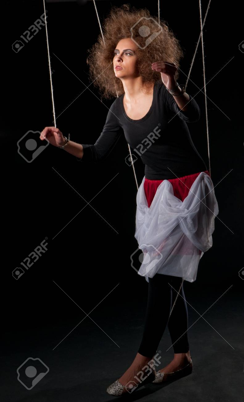 Beautiful doll women with control line standing on black Stock Photo - 8593851