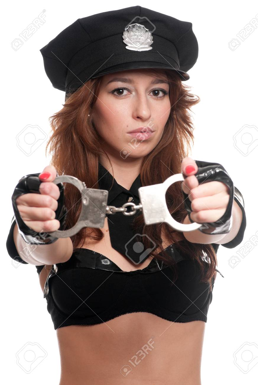 Young beautiful police woman posing in sexy costume isolated on white Stock Photo - 8708053