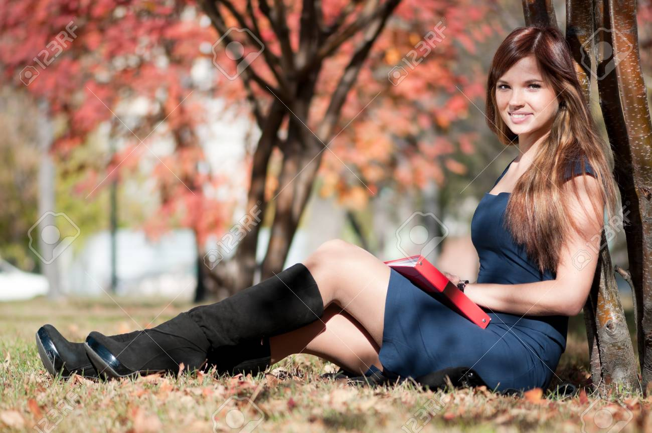 Young business woman planing, writing and reviewing  diary at city park. Student Stock Photo - 9109217
