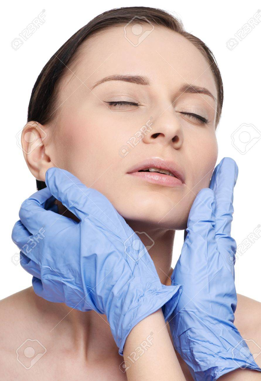 Beautician touch and exam health woman face. Plastic surgery. Isolated Stock Photo - 9402043