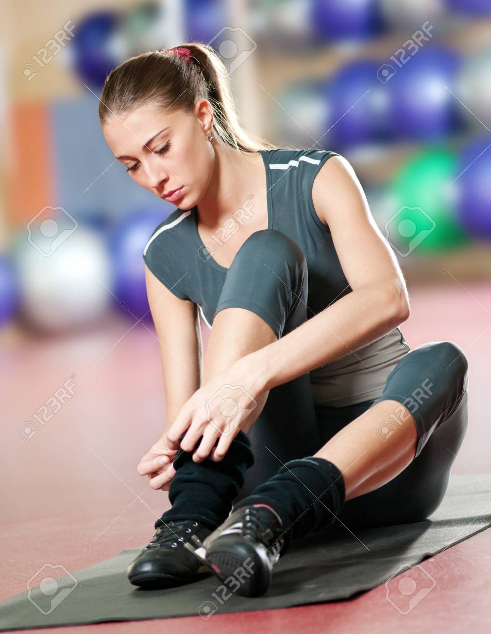 Beautiful sport woman doing stretching fitness exercise at sport gym. Yoga Stock Photo - 9805912