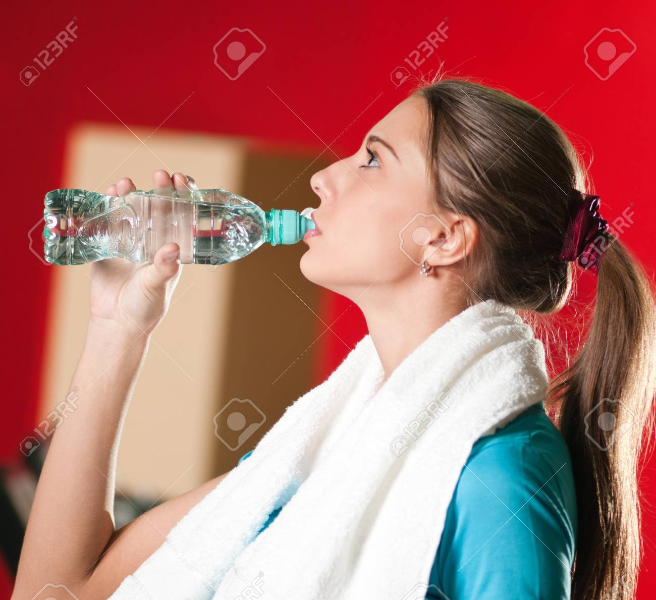 Portrait of a woman at the gym drinking water stock photo picture portrait of a woman at the gym drinking water stock photo 10055676 sciox Gallery