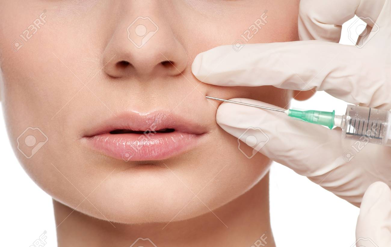Cosmetic botox injection in the female face. Lips zone, Isolated Stock Photo - 9801111