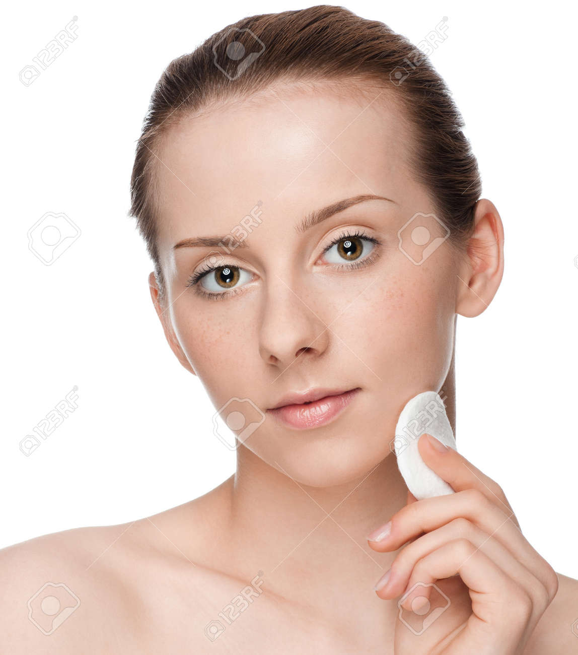 Closeup portrait of young beautiful woman with perfect skin. Applying clean sponge. Isolated Stock Photo - 9839032