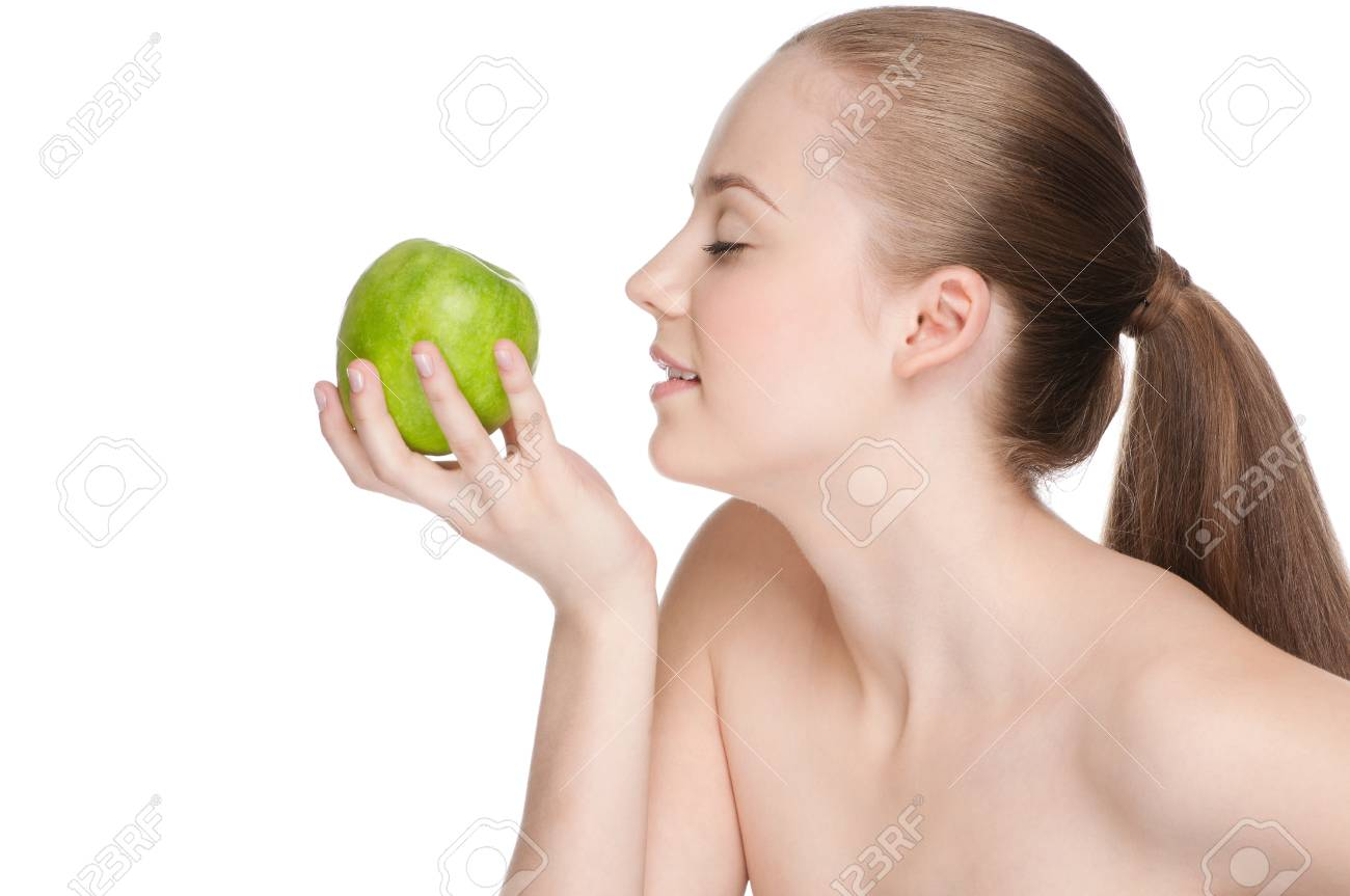 Young woman eat green apple Stock Photo - 10055684