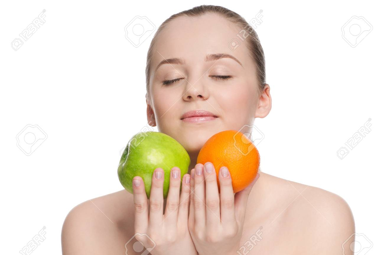 Young woman eat green apple and orange Stock Photo - 10953152