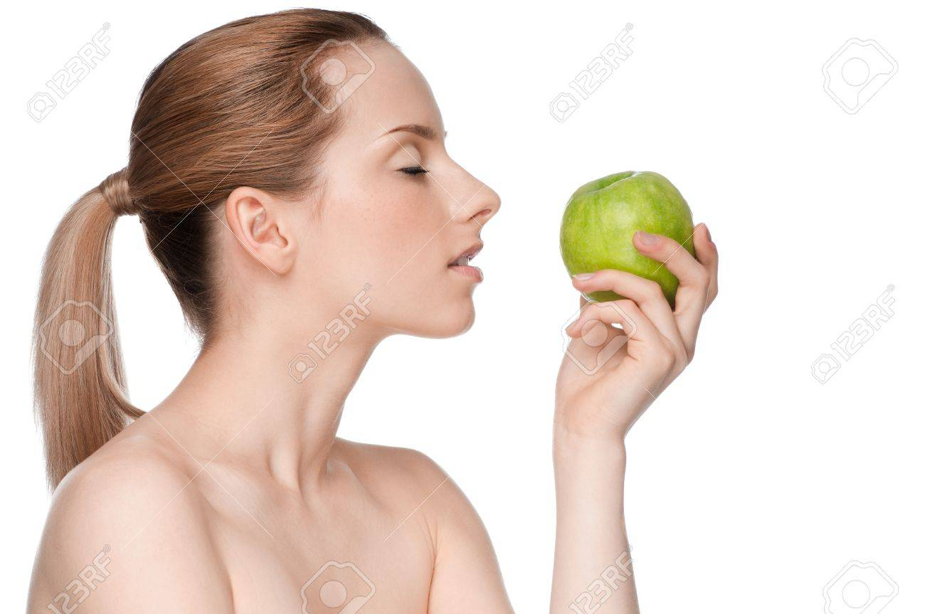 Young woman eat green apple Stock Photo - 11177927