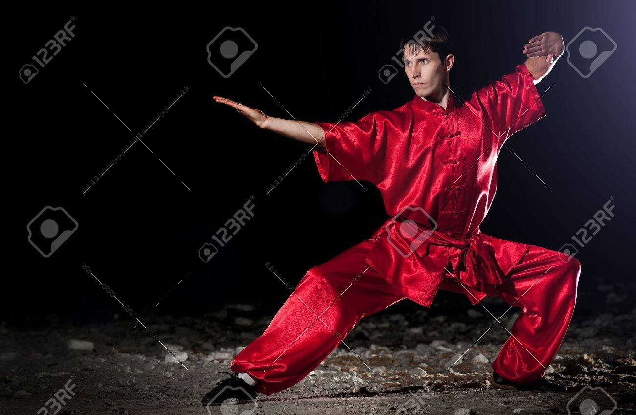 Shaolin warriors wushoo man in red practice martial art outdoor. Kung fu Stock Photo - 11467502
