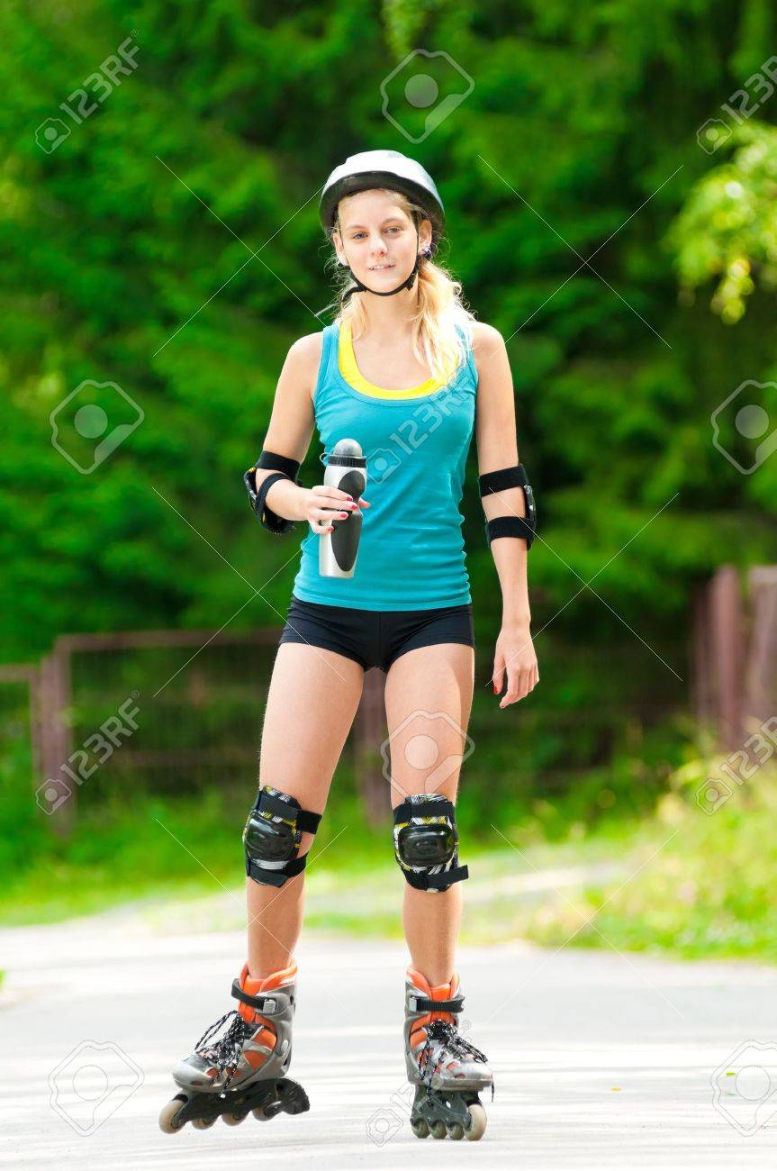 happy young woman on roller skates in the park Stock Photo - 11740272