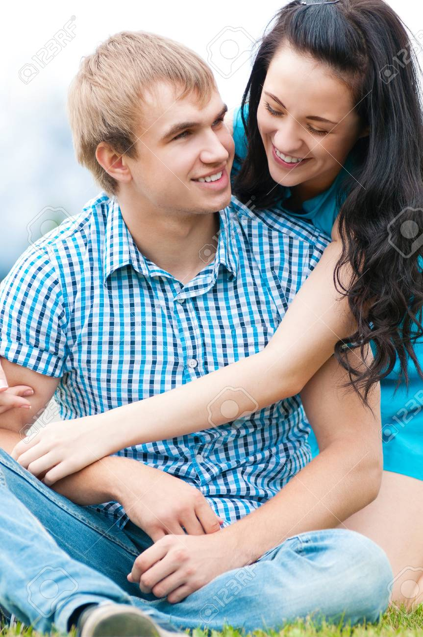 Portrait of a beautiful young happy smiling couple - green park outdoor Stock Photo - 12126038